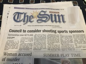 newspaper with the headline: council to consider shooting sports sponsors